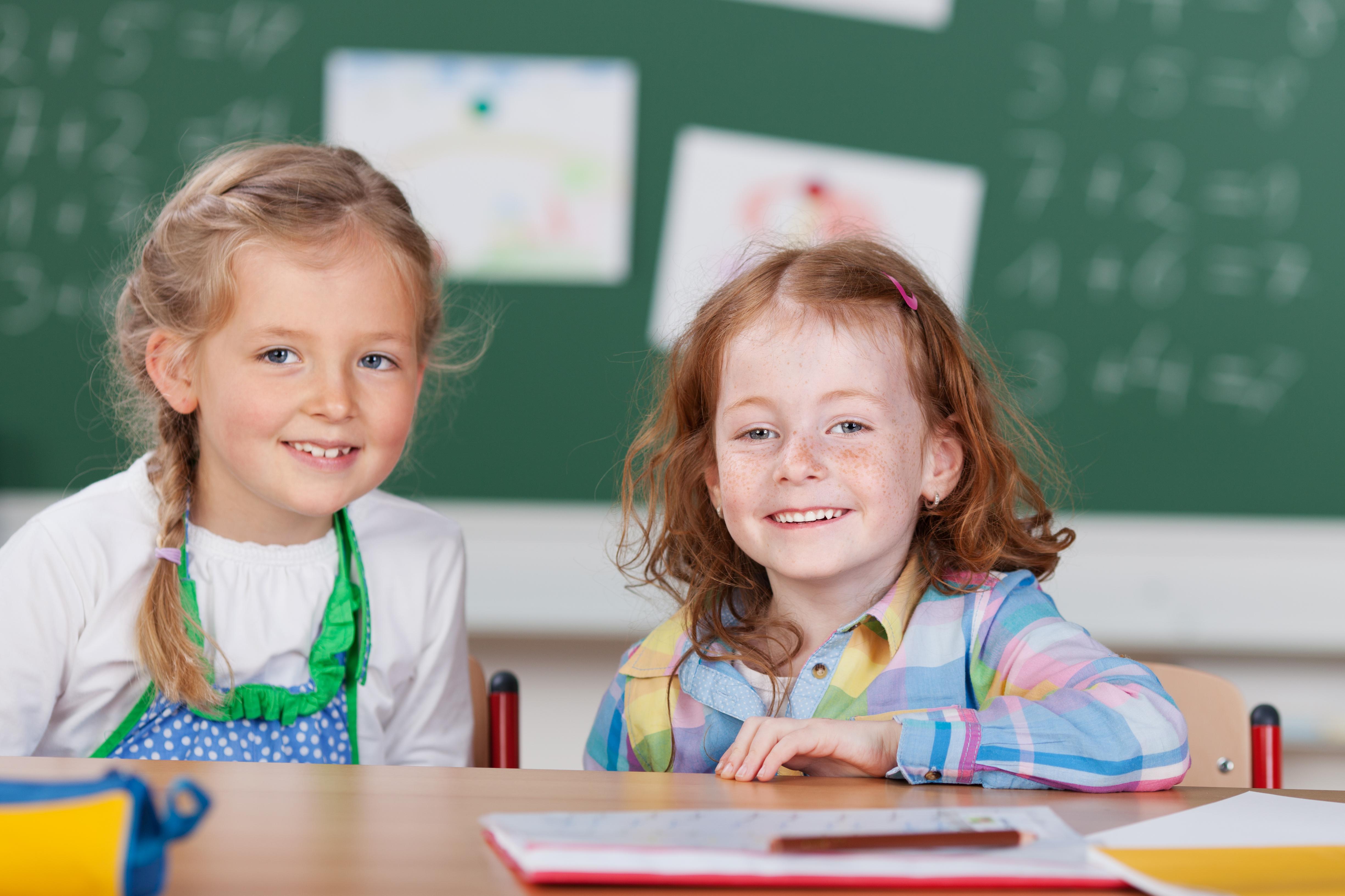 Two happy little girls in kindergarten